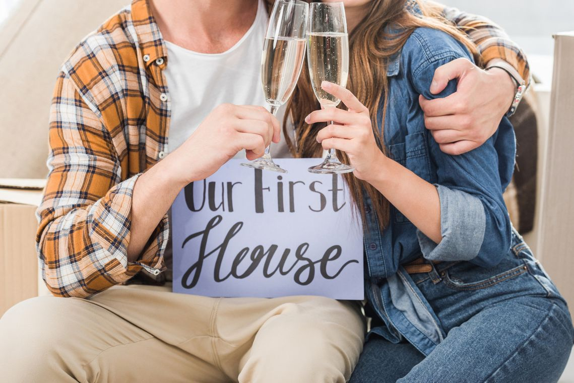 two-people-celebrating-first-house